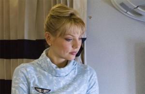 Hôtesse de l'air en service